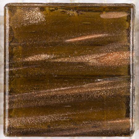 aventurine: beautiful square glass mosaic translucent brown with splashes of brilliant bands aventurine Stock Photo