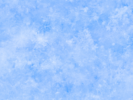 powdery: white-blue powdery snow of beautiful snowflakes lying in the street in winter