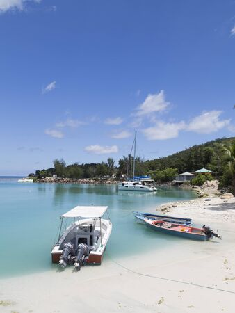la digue: Seychelles - November 7, 2015: Boats and yachts in the port of the island of La Digue and beautiful sea around November 7, 2015, La Digue, Seychelles