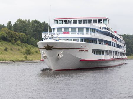 floats: Moskvskaya region - July 9, 2015: Passenger cruise ship Georgy Zhukov floats on the Moscow Canal and the people on the deck of July 9, 2015, Moscow Region, Russia