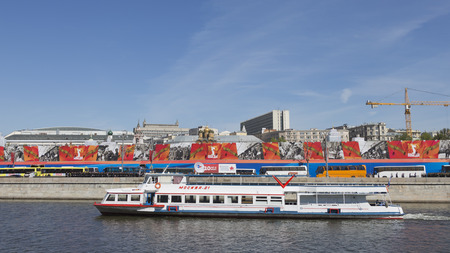 spassky: Moscow - May 7, 2015: A passenger ship Moscow-21 floats on the river against the background of Mokwa crossing the promenade decorated soldiers and foitserov Victory Parade rehearsal on May 7th, 2015, Moscow, Russia