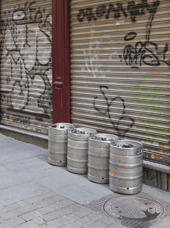 kegs: Madrid - 7 October 2015: Beer kegs made of stainless steel was brought to an even closed the restaurant early in the morning in the streets of Madrid October 7, 2015, Madrid, Spain