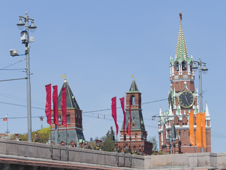 spassky: Moscow - May 7th, 2015: Kremlins Spassky Tower clock - chimes, red flags and soldiers and officers are in uniform after a rehearsal of the parade on Red Square on May 7, 2015, Moscow, Russia Editorial