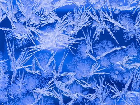 window shade: amazing beautiful fantastic unusual ice frost on window glass frosty cold winters and contrasting shade of blue