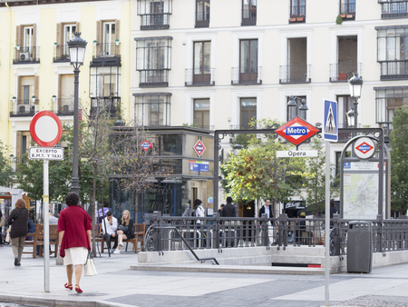 wheelie bin: Madrid - 7 October 2015: Opera metro stations in Madrid and people walk and relax next to the station October 7, 2015, Madrid, Spain