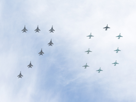 aerobatics: Moscow - May 9, 2015: the MiG-29 and Su-25 performing aerobatics in the sky, and the number 70 on the Victory Parade, which stands for 70 years of the Victory over Nazi Germany May 9, 2015, Moscow Russia