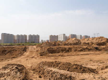protectors: Construction of a new road of light yellow sand fines in a new residential area and traces of protectors of wheels, Russia