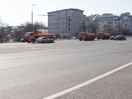 stone wash: Moscow - April 12, 2015: Big orange watering cars go on the Big Stone Bridge and wash the road, in the spring the weather is good April 12, 2015, Moscow, Russia