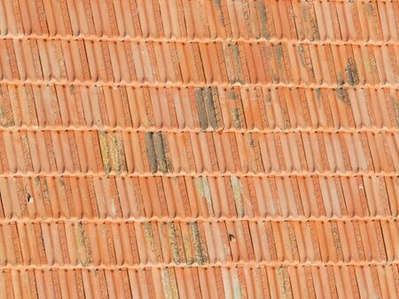precipitation: red tiles is the two slots on the roof, and grown old and rubbed against atmospheric precipitation Stock Photo