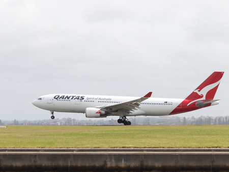Sydney - February 26, 2016: A passenger plane Airbus A330-203 Qantas Ayrvays with kangaroo painted on the tail, landing at the airport in Sydney February 26, 2016, Sydney, Australia Editorial