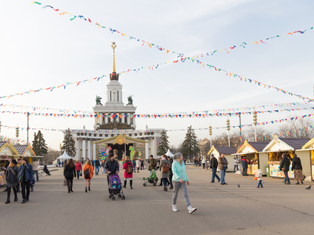 enea: Moscow - March 11, 2016: Funny Mardi Gras celebration, stalls selling pancakes and lots of people came to the fair walk ENEA 11 March 2016, Moscow, Russia