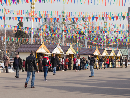 enea: Moscow - March 11, 2016: Cheerful bright festive Mardi Gras, stalls selling pancakes and lots of people came to the fair walk ENEA 11 March 2016, Moscow, Russia