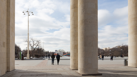 named: Moscow - March 13, 2016: Central entrance to Culture and Recreation Park named after Maxim Gorky, a colonnade, and a lot of people come to the park March 13, 2016, Moscow, Russia Editorial
