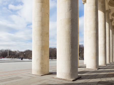 named: Moscow - March 13, 2016: Central entrance to the Park of Culture and Rest named after Gorky, a colonnade, and people walking in the park March 13, 2016, Moscow, Russia Editorial