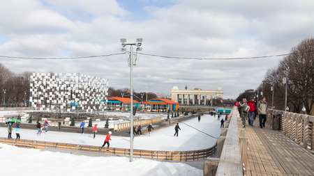 good weather: Moscow - March 13, 2016: Lots of happy people ice-skating at the rink in the Park of Culture and Rest named after Gorky in good weather and snow is March 13, 2016, Moscow, Russia