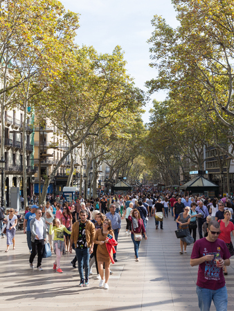 rambla: Barcelona - 10 October 2015: Many people and tourists stroll on the main tourist street of Barcelona - Rambla October 10, 2015, Barcelona, Spain Editorial