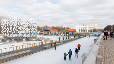 named: Moscow - March 13, 2016: Lots of happy people ice-skating at the rink in the Park of Culture and Rest named after Gorky in good weather, March 13, 2016, Moscow, Russia