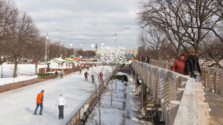 iceskating: Moscow - March 13, 2016: Lots of happy people ice-skating at the rink in the Park of Culture and Rest named after Gorky in good weather and Snow White is March 13, 2016, Moscow, Russia Editorial