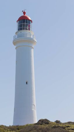 ayers: Melbourne - February 23, 2016: Tall white lighthouse Ayers Inlet on the Great Ocean Road on a clear blue sky February 23, 2016, Melbourne, Australia