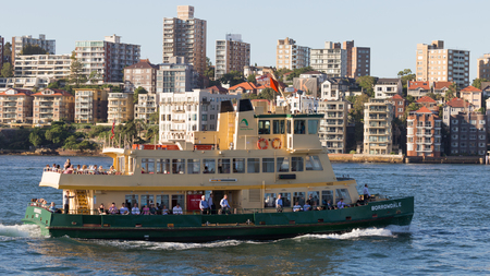 borrowdale: Sydney - February 25, 2016: Beautiful green-yellow passenger Sydney ferry carries passengers to the port of Sydney February 25, 2016, Sydney, Australia Editorial