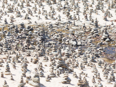 fulfill: Many pyramid of round stones - Lutz, who put people to fulfill their desires on the Great Ocean Road, Australia Stock Photo