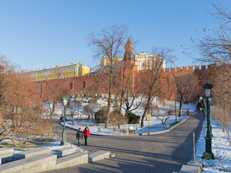 star path: Moscow - November 29, 2015: Beautiful Alexander Garden near the Kremlin in ancient frost and people walk and trees are bare and the snow is November 29, Moscow, Russia