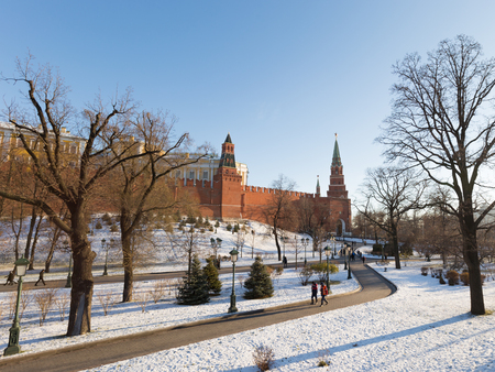 star path: Moscow - November 29, 2015: Alexander Garden near the Kremlin in ancient frost and people walk and trees are bare and the snow is November 29, Moscow, Russia