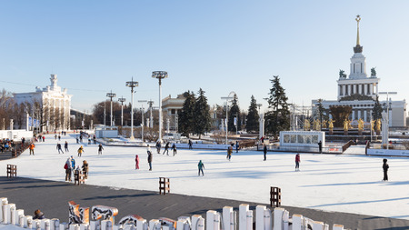 enea: Moscow - November 28, 2015: Lots of happy people and tourists relax and skate in a large park in the winter ENEA November 28, 2015, Moscow, Russia