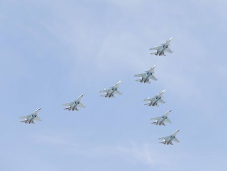 aerobatic: Moscow-May 9, 2015: Aerobatic team Russian Falcons eight military gray-blue Su-30 is flying high in the sky at the Victory Day parade May 9, 2015, Moscow, Russia