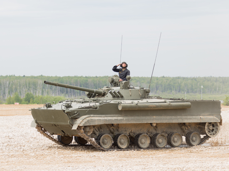 tracked: Moscow Region - June 19 2015: On the firing line extends combat armored tracked vehicle BMP-3 on the demonstrations and military salutes on polegone Kubinka June 19, 2015 Moscow Region, Russia Editorial