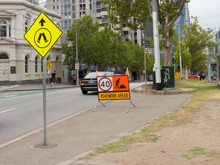 informing: Melbourne - February 22, 2016: Bright signs, informing about road repairs on the streets February 22, 2016, Melbourne, Australia