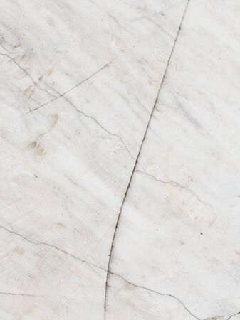 blond streaks: old uneven light gray marble and white with blond streaks and spots Stock Photo