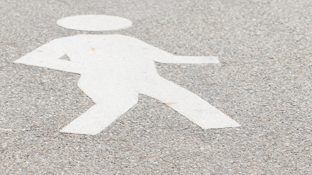 convex: convex white man icon, made a special paint on the gray asphalt on the street