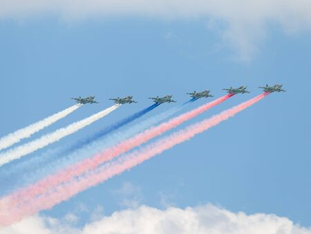 may fly: Moscow - May 7, 2016: Six Su-25 fired smoke colors of the Russian flag on the aerial part of the Victory Day parade May 7, 2016, Moscow, Russia