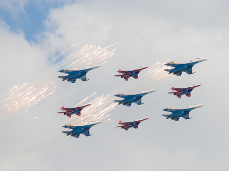 mig: Moscow - May 7, 2016: Nine of Su-27 and MiG-29 fired a salute and feyervek as part of a rhombus, an air of the Victory Day parade May 7, 2016, Moscow, Russia Editorial