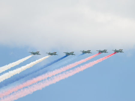 may fly: Moscow - May 7, 2016: Six powerful Su-25 fired smoke colors of the Russian flag on the aerial part of the Victory Day parade May 7, 2016, Moscow, Russia Editorial