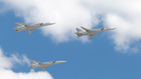 may fly: Moscow - May 7, 2016: Three powerful sverhzukovyh aircraft strategic bombers Tu-160 White swans fly in the sky over Red Square on May 7, 2016, Moscow, Russia Editorial