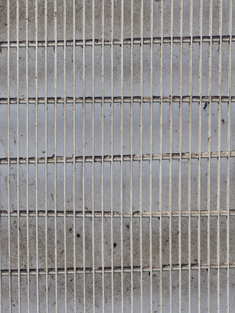 crack pipe: gray painted metal surface of old and dirty metal bars on the street vertically