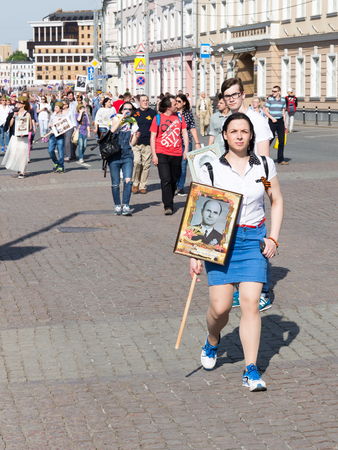 immortal: Moscow - May 9, 2016: Protesters Immortal regiment, with St. George ribbons, go after the demonstration May 9, 2016, Moscow, Russia Editorial