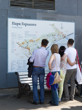 gorky: Moscow - May 9, 2016: People studying the map to visit and relax in the Gorky Park May 9, 2016, Moscow, Russia Editorial
