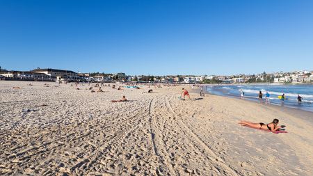 foam safe: Sydney - March 1, 2016: A large urban beach and people relax and swim in the blue sea at the beach in the evening March 1, 2016, Sydney, Australia