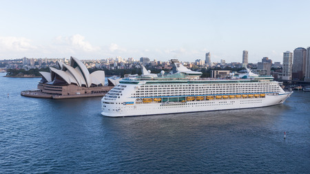 voyager: Sydney - February 27, 2016: Cruise ship Voyager of seas goes vport of Sydney and Sydney Opera House view from Harbour Bridge February 27, 2015, Sydney, Australia Editorial