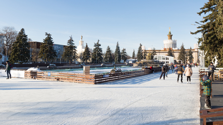 enea: Moscow - November 28, 2015: Lots of happy people relax and skate on the large outdoor skating rink in winter park ENEA 2016 November 28, 2015, Moscow, Russia