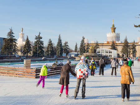 enea: Moscow - November 28, 2015: Many people have a rest and ice-skating on the large outdoor skating rink in winter park beautiful ENEA 2016 November 28, 2015, Moscow, Russia Editorial