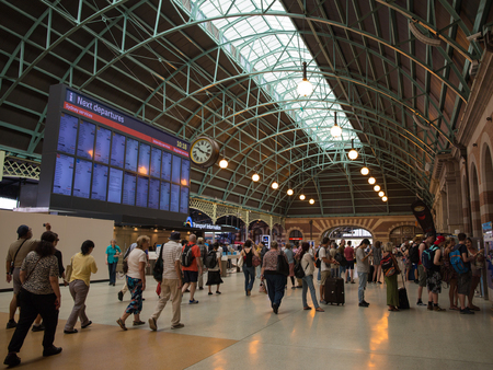 go inside: Sydney - February 25, 2016: Scoreboard Central Station in Sydney and a lot of people and tourists traveling railways February 25, 2016, Sydney, Australia