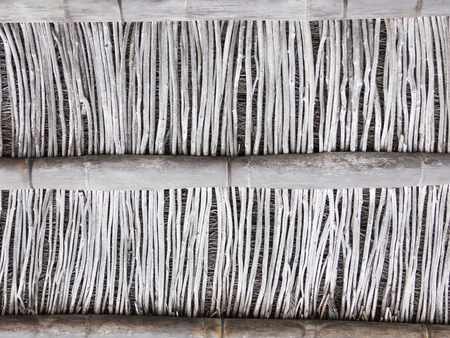 wooden partition: old gray wall partition of large and small dilapidated dry bamboo Stock Photo