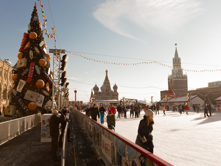 iceskating: Moscow - November 29, 2015: New Year on Red Square skating rink, Christmas tree in retro style and people ice-skating near the Kremlin November 29, 2015, Moscow, Russia Editorial