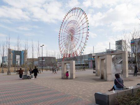 good weather: Tokyo - 7 February 2015: Beautiful fashionable district of Tokyo - Odaiba and a beautiful park, and people walk in good weather 7 February, Tokyo, Japan