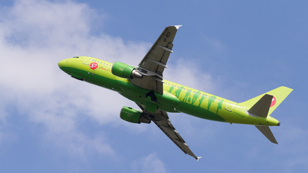 Moscow region - 31 July 2016: Green passenger aircraft Airbus A320-21 S7 Airlines flies to Moscows Domodedovo airport July 31, 2016, Moscow Region, Russia