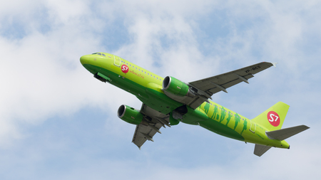 Moscow region - 31 July 2016: a beautiful passenger aircraft Airbus A320-21 S7 Airlines flies to Moscows Domodedovo airport July 31, 2016, Moscow Region, Russia Editorial